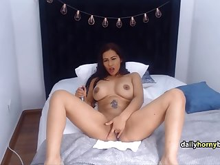 half asian babe plays with dildo