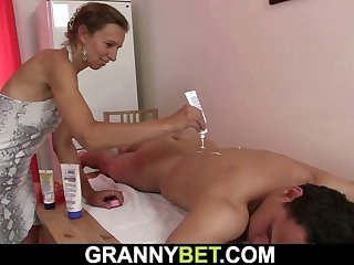 hairy pussy old masseuse gives head and rides his cock
