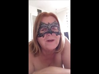 granny has a bright red pussy and a big  strap-on